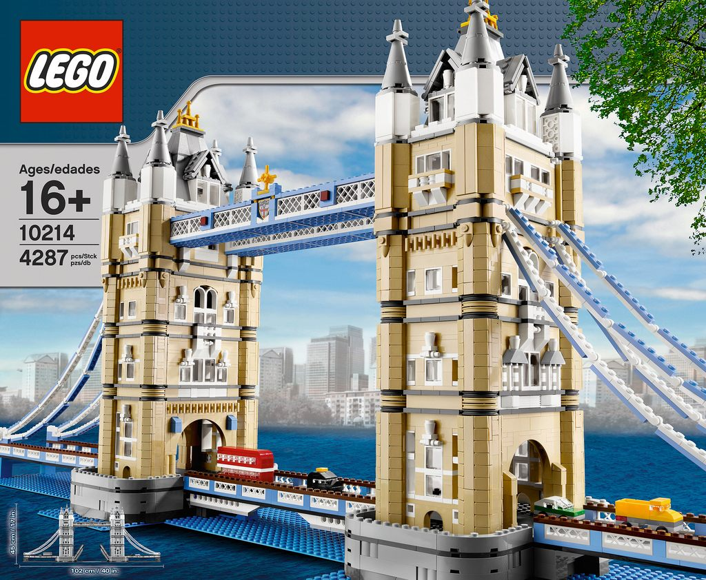 A model of London's Tower Bridge made out of Lego, complete with a miniature brick-built red double decker bus and a black cab