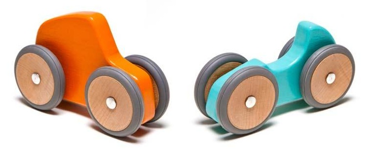 Brightly coloured toy cars with circular wooden wheels with rubber tyres, attached to the wooden car body by invisible magnets
