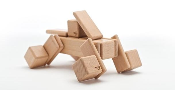 Rounded wooden building blocks, held together by invisible magnets